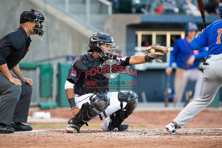 Northwest Arkansas Naturals catcher Meibrys Viloria (22) catches a pitch on May 4, 2019, at Arvest Ballpark in Springdale, Arkansas. (Jason Ivester/Four Seam Images)