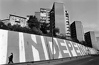 """Spain. Basque Country. Spain. Basque Country. Bilbao is the largest city in the province of Biscay and in the Basque Country as a whole. A woman walks on the sidewalk. On the wall, a giant political graffiti wit the written words """" Independentzia """" ( Independence). The Basque Country should be free and independent from Spain and France. The Basque Country (Euskadi, País Vasco, Pays Basque), officially the Basque Autonomous Community (Euskal Autonomia Erkidegoa, Comunidad Autónoma Vasca, CAV) is an autonomous community in northern Spain. It includes the Basque provinces of Álava, Biscay, and Gipuzkoa. The Basque Country or Basque Autonomous Community was granted the status of nationality within Spain, attributed by the Spanish Constitution of 1978. The autonomous community is based on the Statute of Autonomy of the Basque Country, a foundational legal document providing the framework for the development of the Basque people on Spanish soil. 20.03.92 © 1992 Didier Ruef"""