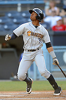 Charleston RiverDogs second baseman Angelo Gumbs #21 swings at a pitch during a game against the Asheville Tourists at McCormick Field on May 28, 2012 in Asheville, North Carolina . The Tourists defeated the RiverDogs 15-12. (Tony Farlow/Four Seam Images).