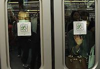 Passengers squashed against the glass on a train during rush-hour in Shinjuku Station, Tokyo, Japan.With up to 4 million passengers passing through it every day, Shinjuku station, Tokyo, Japan, is the busiest train station in the world. The station was used by an average of 3.64 million people per day.  That's 1.3 billion a year.  Or a fifth of humanity. Shinjuku has 36 platforms, and connects 12 different subway and railway lines.  Morning rush hour is pandemonium with all trains 200% full. <br /> <br /> Photo by Richard jones / sinopix