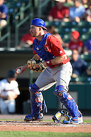 Buffalo Bisons catcher Erik Kratz (39) checks the runner after blocking a pitch in the dirt during the second game of a doubleheader against the Rochester Red Wings on July 6, 2014 at Frontier Field in Rochester, New  York.  Rochester defeated Buffalo 6-1.  (Mike Janes/Four Seam Images)