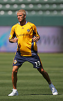 David Beckham warms up at his first practice with the LA Galaxy at the Home Depot Center in Carson, California, Monday, July 16, 2007.