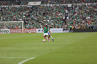 Mexico City, Mexico - Sunday June 11, 2017: Javier Aquino, DaMarcus Beasley during a 2018 FIFA World Cup Qualifying Final Round match with both men's national teams of the United States (USA) and Mexico (MEX) playing to a 1-1 draw at Azteca Stadium.