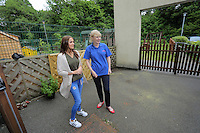 Erin McGeough of Amazon is shown around by Judy Lynch