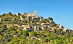 View of the Luberon hill town of Lacoste, in Provence, France. At the top is the partly destroyed château of the Marquis de Sade, now owned by fashion designer Pierre Cardin.