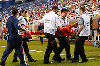 Panama forward Luis Rentería (16) is carried off the pitch in pain during the CONCACAF soccer match between Panama and Guadeloupe at Ford Field Detroit, Michigan.