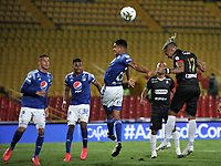 BOGOTA - COLOMBIA, 17-12-2020: Juan Pablo Vargas, Kliver Moreno, Stiven Vega de Millonarios F. C. y Dayro Moreno de Once Caldas disputan el balon, durante partido entre Millonarios F. C. y Once Caldas de la Semifinales por la Liguilla BetPlay DIMAYOR 2020 jugado en el estadio Nemesio Camacho El Campin de la ciudad de Bogota. / Juan Pablo Vargas, Kliver Moreno, Stiven Vega of Millonarios F. C. and Dayro Moreno of Once Caldas figth for the ball, during a match between Millonarios F. C. and Once Caldas of the Semifinals for the BetPlay DIMAYOR 2020 Liguilla played at the Nemesio Camacho El Campin Stadium in Bogota city. / Photo: VizzorImage / Luis Ramirez / Staff.