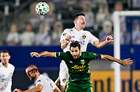 CARSON, CA - OCTOBER 07: Sacha Kljestan #16 of the Los Angeles Galaxy leaps over Diego Valeri #8 of the Portland Timbers for a head ball during a game between Portland Timbers and Los Angeles Galaxy at Dignity Heath Sports Park on October 07, 2020 in Carson, California.