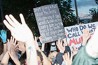 """Thousands gathered outside the Massachusetts State House in Boston, Massachusetts, on Sun., May 31, 2020, to demonstrate against police brutality after the killing by police of George Floyd in Minneapolis, Minnesota, the previous week. Protests, sometimes violent, have erupted around the United States. This protest was organized by an organization called Black Boston. Protesters often chanted """"Black Lives Matter"""" and """"Fuck the police."""" The protest began at 6:30pm in various parts of the city, and around 9pm, after most protesters had left, there began to be clashes between people and police, especially in the Downtown Crossing area of Boston and around Boston Common.  The protest sign here reads """"Start giving a fuck about the brutal slaughtering of black women and men in this country done by the hands of the people you let stay in power by keeping your mouths shut."""""""