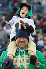 November 19, 2011; Notre Dame Fighting Irish fans Joe Rozick and son Zaine 3, from Colorado, watches the players on the field during warm-up prior to the game against the Boston College Eagles. Photo by Barbara Johnston/University of Notre Dame
