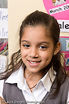 Closeup portrait of girl smiling early primary grades vertical