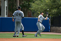 Wake Forest Demon Deacons right fielder Keegan Maronpot (13) makes a running catch in front of first baseman Gavin Sheets (24) and second baseman Jake Mueller (6) during the game against the Florida Gators in Game One of the Gainesville Super Regional of the 2017 College World Series at Alfred McKethan Stadium at Perry Field on June 10, 2017 in Gainesville, Florida.  (Brian Westerholt/Four Seam Images)