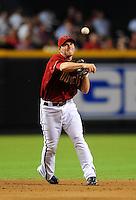 Jul. 28, 2009; Phoenix, AZ, USA; Arizona Diamondbacks shortstop Stephen Drew throws to first base against the Philadelphia Phillies at Chase Field. Mandatory Credit: Mark J. Rebilas-