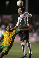APR 11, 2006: Cary, North Carolina:  USWNT midfielder (8) Clint Dempsey goes up for a header against Jamaican defender (19) Garfield Reid during a friendly at the SAS Soccer Park in Cary, North Carolina