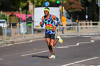 3rd October 2021; London, England: The Virgin Money 2021 London Marathon: Shura Kitata of Ethiopia running on Butcher Row, Limehouse between mile 21 and 22 starting towards central London and the finish.