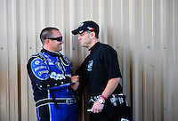 Jul. 24, 2011; Morrison, CO, USA: NHRA top fuel dragster driver Larry Dixon (right) shakes hands with Brandon Bernstein during the Mile High Nationals at Bandimere Speedway. Mandatory Credit: Mark J. Rebilas-