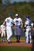 South Dakota State Jackrabbits head coach Rob Bishop (26) takes the ball from starting pitcher Ryan Froom (35) while making a pitching change with catcher Ryan McDonald (8) looking on during a game against the Northeastern Huskies on February 23, 2019 at North Charlotte Regional Park in Port Charlotte, Florida.  Northeastern defeated South Dakota State 12-9.  (Mike Janes/Four Seam Images)