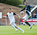 Dundee's Kevin Thomson takes a high ball as Caley's Josh Meekings looks on.