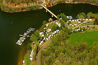 Aerial photography of and around Watauga Lake, Tenn., taken April 2011. Surrounded by the Cherokee National Forest, the vast majority of Watauga Lake's shoreline and surrounding mountains is undeveloped and pristine. Even during busy holiday weekends (photo taken on Easter weekend 2011) the large lake is rarely busy with boaters. Photo shows Pioneer Landing Marina and Resort.