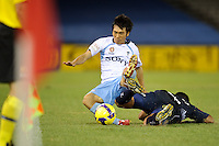 MELBOURNE, AUSTRALIA - FEBRUARY 18, 2010: Carlos Hernandez from Melbourne Victory tackles Sung Hwan Byun from Sydney FC for the ball in the first leg of the A-League Major Semi Final match between the Melbourne Victory and Sydney FC at Etihad Stadium on February 18, 2010 in Melbourne, Australia. Photo Sydney Low www.syd-low.com