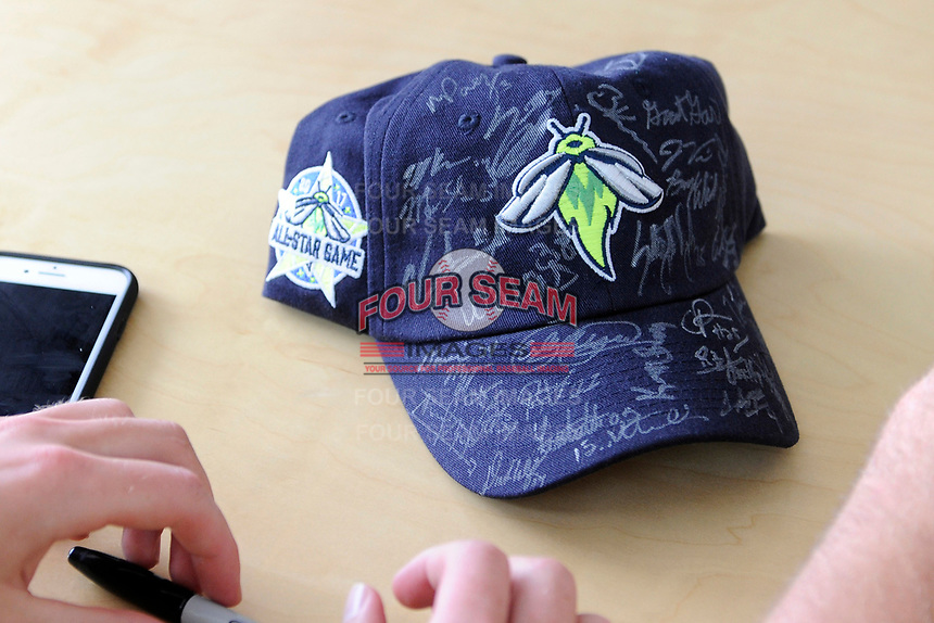 A signed hat from the Columbia Fireflies at the South Atlantic League All-Star Game Fan Fest on Tuesday, June 20, 2017, at Spirit Communications Park in Columbia, South Carolina. The game was suspended due to rain after seven innings tied, 3-3. (Tom Priddy/Four Seam Images)