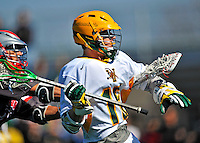 17 March 2012: University of Vermont Catamount Midfielder Mac Hall, a Freshman from Baltimore, MD, in action against the Sacred Heart University Pioneers at Virtue Field in Burlington, Vermont. The Catamounts defeated the visiting Pioneers 12-11 with only 10 seconds remaining in their non-conference matchup. Mandatory Credit: Ed Wolfstein Photo
