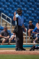 Home plate umpire Lane Cullipher makes a strike call during the game between the Lynchburg Hillcats and the Kannapolis Cannon Ballers at Atrium Health Ballpark on August 29, 2021 in Kannapolis, North Carolina. (Brian Westerholt/Four Seam Images)