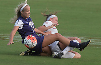 NWA Democrat-Gazette/J.T. WAMPLER Arkansas' Carley Hoke (right) gets tangled up with TCU's Makenzie Koch Sunday August 23, 2015 during the Lady Backs opening game at home.