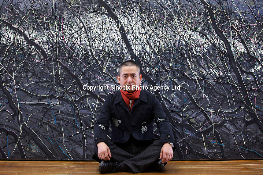 """Zeng Fanzhi, China's renowned contemporary artist, poses for pictures  in his Beijing studio on 9th November, 2012, China. Zeng gained the title of """"Number ONe"""" Chinese artist in terms of auction price in 2009.<br /> <br /> PHOTO BY RICKY WONG / SINOPIX"""