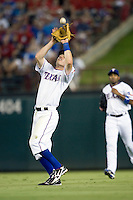 Texas Rangers second baseman Ian Kinsler #5 makes a catch during the Major League Baseball game against the Texas Rangers at the Rangers Ballpark in Arlington, Texas on July 27, 2011. Minnesota defeated Texas 7-2.  (Andrew Woolley/Four Seam Images)