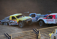 Dec. 10, 2011; Chandler, AZ, USA;  LOORRS pro 2 unlimited driver Rob Naughton (54) and Robby Woods (99) during round 15 at Firebird International Raceway. Mandatory Credit: Mark J. Rebilas-