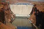 DAM REFLECTS IN WATER AT GLEN CANYON DAM