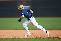 Mason Pickard (13) of the Queens Royals takes off for second base during the game against the Catawba Indians during game one of a double-header at Tuckaseegee Dream Fields on March 26, 2021 in Kannapolis, North Carolina. (Brian Westerholt/Four Seam Images)
