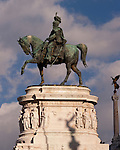 A bronze statue of the emperor towers in front of the imposing monument to Emperor Vittorio Emanuele II in the heart of Rome, Italy.  Vitorio Emanuele II first brought all of Italy into one nation.