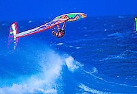 A windsurfer flies into the air at world famous Hookipa Beach Park on Maui.