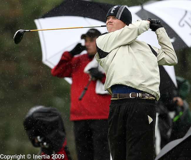 SIOUX FALLS, SD - OCTOBER 5: Tyler Zahn of Aberdeen Central watches his tee shot on the 10th hole during the first round of the 2009 South Dakota Class AA Boys Golf Tournament Monday at Westward Ho Country Club in Sioux Falls. Rain and temperatures in the mid 40's made playing conditions extremely difficult. (Photo by Dave Eggen/Inertia)