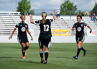 Hayley Siegel (12) of the D.C. United Women celebrates her goal with teammates Lianne Sanderson (10) and Molly Menchel (14) during the game at the Maryland SoccerPlex in Boyds, Maryland.  The D.C. United Women defeated the Charlotte Lady Eagles, 3-0, to win the W-League Eastern Conference Championship.