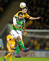 MOTHERWELL'S STEVEN JENNINGS ANDHIBERNIAN'S JORGE CLAROS CHALLENGE FOR A HIGH BALL