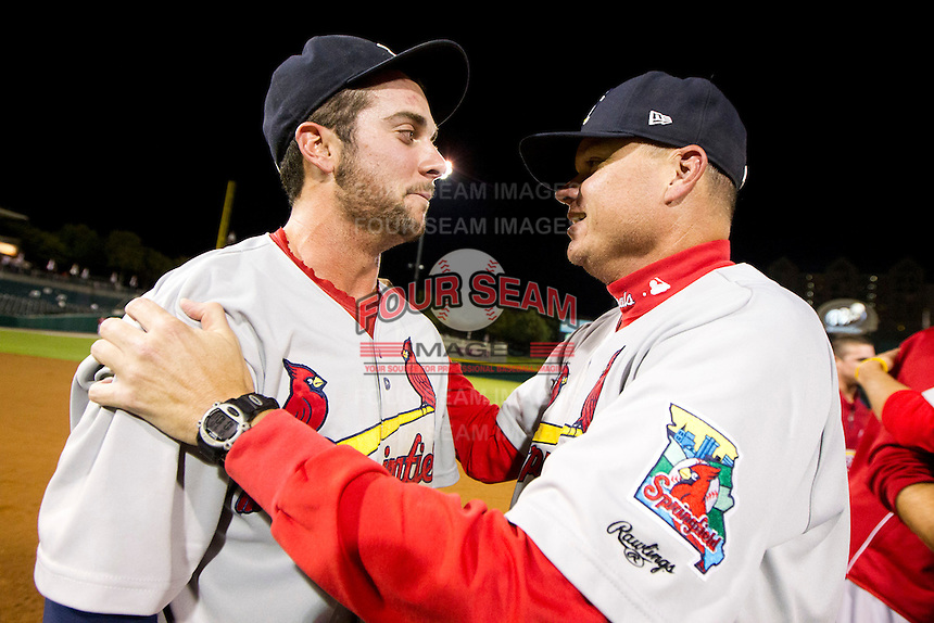 Greg Garcia (7) and Manager Mike Shildt (8) of the Springfield Cardinals celebrate after game 3 of the Texas League Championship Series against the Frisco RoughRiders at Dr. Pepper BallPark on September 15, 2012 in Frisco, TX.  The Cardinals became the 2012 Texas League Champions after defeating the RoughRiders 2-1. (David Welker/Four Seam Images)
