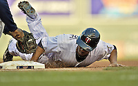 29 September 2012: Minnesota Twins outfielder Ben Revere dives back to first during a game against the Detroit Tigers at Target Field in Minneapolis, MN. The Tigers defeated the Twins 6-4 in the second game of their 3-game series. Mandatory Credit: Ed Wolfstein Photo
