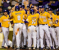 Mikie Mahtook #8 of the LSU Tigers is greeted by teammates after scoring a run in the first inning against the Wake Forest Demon Deacons at Alex Box Stadium on February 18, 2011 in Baton Rouge, Louisiana.  The Tigers defeated the Demon Deacons 15-4.  Photo by Brian Westerholt / Four Seam Images