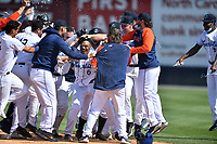 Asheville Tourists celebrate a walk-off hit by A.J. Lee against the Greenville Drive on May 23, 2021 at McCormick Field in Asheville, NC. (Tony Farlow/Four Seam Images)