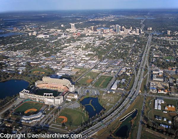 aerial photograph of the Camping World Stadium also known as the Orlando Stadium, Tangerine Bowl and Florida Citrus Bowl toward the skyline of Orlando,  Florida