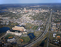 aerial photograph of the Camping World Stadium also known as the Orlando Stadium, Tangerine Bowl and Florida Citrus Bowl toward the skyline of Orlando,  Florida