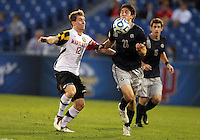 HOOVER, AL - DECEMBER 07, 2012:  Jereme Raley (12) of the University of Maryland defends against Andy Riemer (20) of Georgetown University during an NCAA 2012 Men's College Cup semi-final match, at Regents Park, in Hoover , AL, on Friday, December 07, 2012. The game ended in a 4-4 tie, after overtime Georgetown won on penalty kicks.