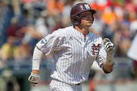 Mississippi State outfielder Hunter Renfroe (34) hustles down the first base line during Game 11 of the 2013 Men's College World Series against the Oregon State Beavers on June 21, 2013 at TD Ameritrade Park in Omaha, Nebraska. The Bulldogs defeated the Beavers 4-1, to reach the CWS Final and eliminating Oregon State from the tournament. (Andrew Woolley/Four Seam Images)