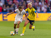 LE HAVRE,  - JUNE 20: Tobin Heath #17 fights for the ball with Caroline Seger #17 during a game between Sweden and USWNT at Stade Oceane on June 20, 2019 in Le Havre, France.