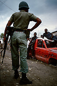 Gonaives, Haiti.November 21, 1987..The military patrols the streets of cites outside the capital in anticipation of violent clashes prior to elections being held on November 29th. It was to be the first attempt at a democratic election in Haiti. It was unsuccessful as 34 people were killed at a polling station and elections were moved up to February 1988...Leslie François Manigat won the election with many political parties boycotting. He had military backing but once in office he sought greater control over the military in an effort, to fight corruption. Manigat's government was overthrown by General Henri Namphy within months.
