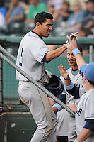 Outfielder Rafael Ortega (5) of the Asheville Tourists, Class A affiliate of the Colorado Rockies, in a game against the Greenville Drive on May 1, 2011, at Fluor Field at the West End in Greenville, S.C. Photo by Tom Priddy / Four Seam Images
