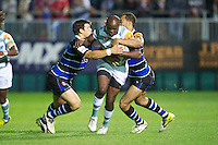 20120803 Copyright onEdition 2012©.Free for editorial use image, please credit: onEdition..Topsy Ojo of London Irish is tackled by Guy Mercer (left) and Richard Lane of Bath Rugby at The Recreation Ground, Bath in the Final round of The J.P. Morgan Asset Management Premiership Rugby 7s Series...The J.P. Morgan Asset Management Premiership Rugby 7s Series kicked off again for the third season on Friday 13th July at The Stoop, Twickenham with Pool B being played at Edgeley Park, Stockport on Friday, 20th July, Pool C at Kingsholm Gloucester on Thursday, 26th July and the Final being played at The Recreation Ground, Bath on Friday 3rd August. The innovative tournament, which involves all 12 Premiership Rugby clubs, offers a fantastic platform for some of the country's finest young athletes to be exposed to the excitement, pressures and skills required to compete at an elite level...The 12 Premiership Rugby clubs are divided into three groups for the tournament, with the winner and runner up of each regional event going through to the Final. There are six games each evening, with each match consisting of two 7 minute halves with a 2 minute break at half time...For additional images please go to: http://www.w-w-i.com/jp_morgan_premiership_sevens/..For press contacts contact: Beth Begg at brandRapport on D: +44 (0)20 7932 5813 M: +44 (0)7900 88231 E: BBegg@brand-rapport.com..If you require a higher resolution image or you have any other onEdition photographic enquiries, please contact onEdition on 0845 900 2 900 or email info@onEdition.com.This image is copyright the onEdition 2012©..This image has been supplied by onEdition and must be credited onEdition. The author is asserting his full Moral rights in relation to the publication of this image. Rights for onward transmission of any image or file is not granted or implied. Changing or deleting Copyright information is illegal as specified in the Copyright, Design and Patents Act 1988. If you are in any way unsure of your